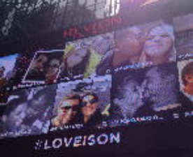 As part of Revlon's social media campaign, photos with the hashtag #LOVEISON have a chance to be seen on Revlon's Times Square digital billboard