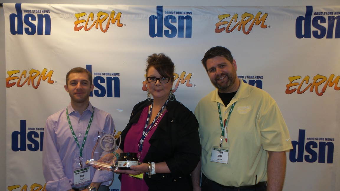 New Product Award winner Topganic EVP Elizabeth DeMaria, center, with DSN's Alex Tomas (left) and ECRM's Josh Clyne