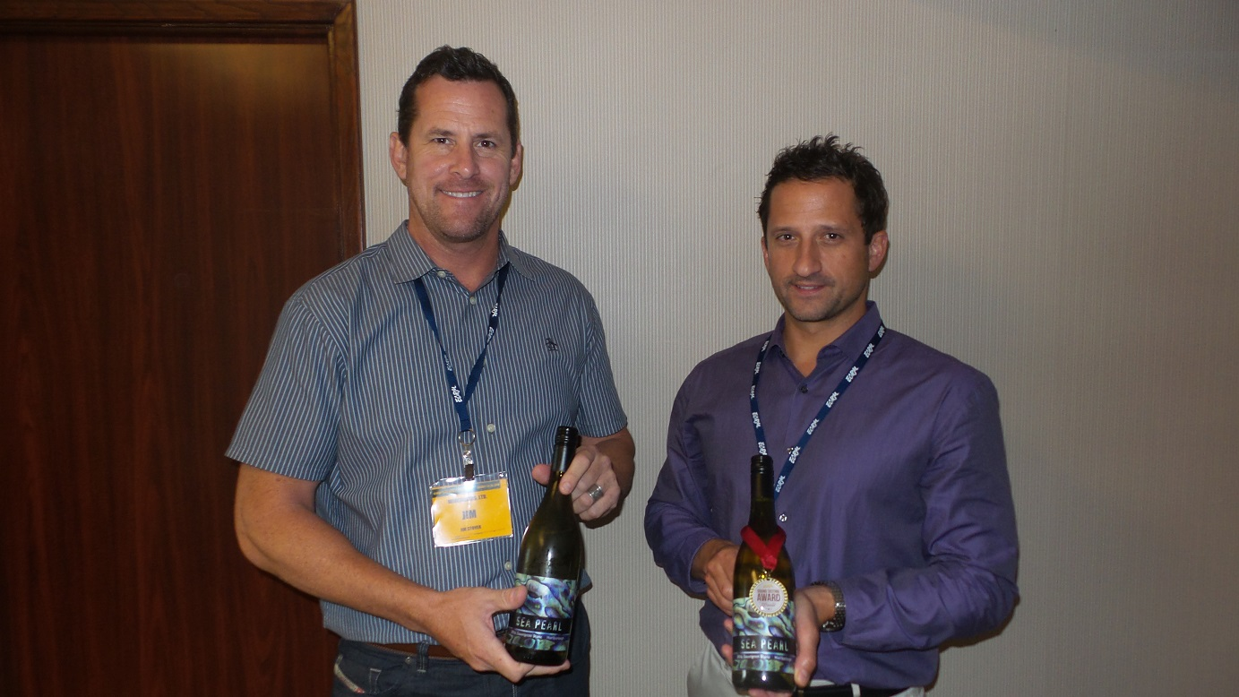 From left: Jim Stover and Adam Sager from Winesellers, Off-Premise Award winner