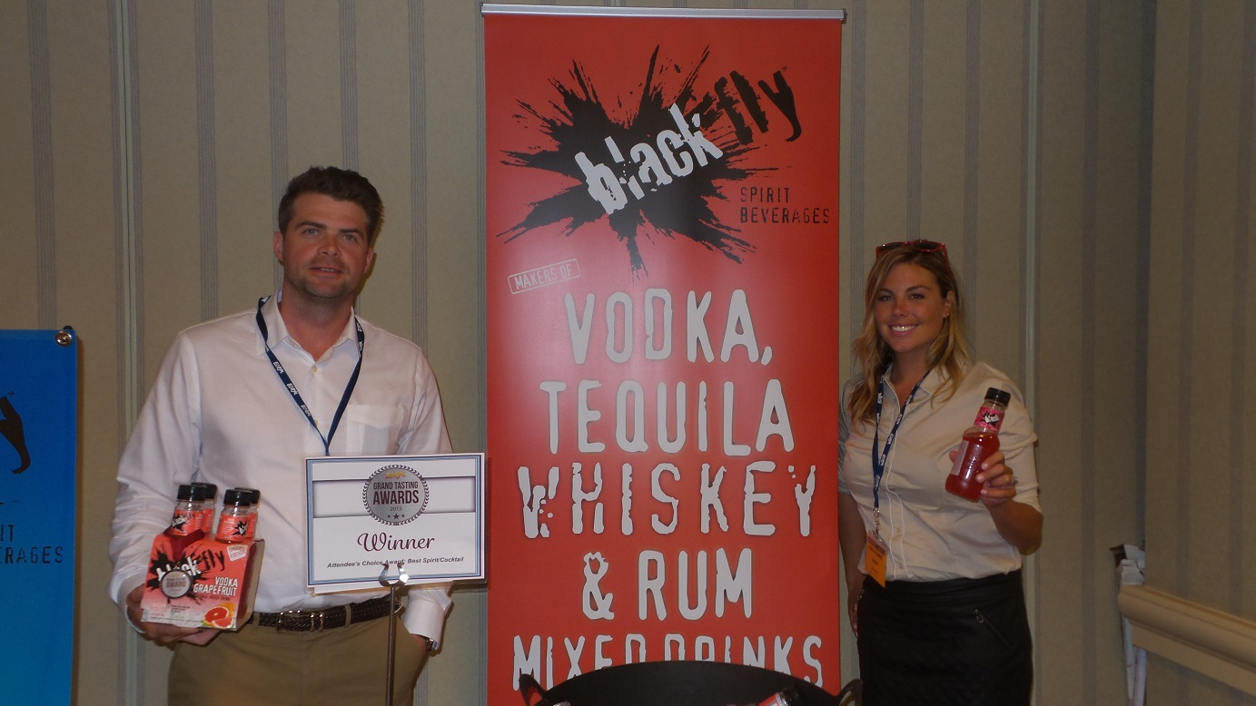 From left: Mike Pearce, VP of Sales & Marketing, and Chelsea McArthur, Regional Sales Manager, Black Fly Beverages, winner of