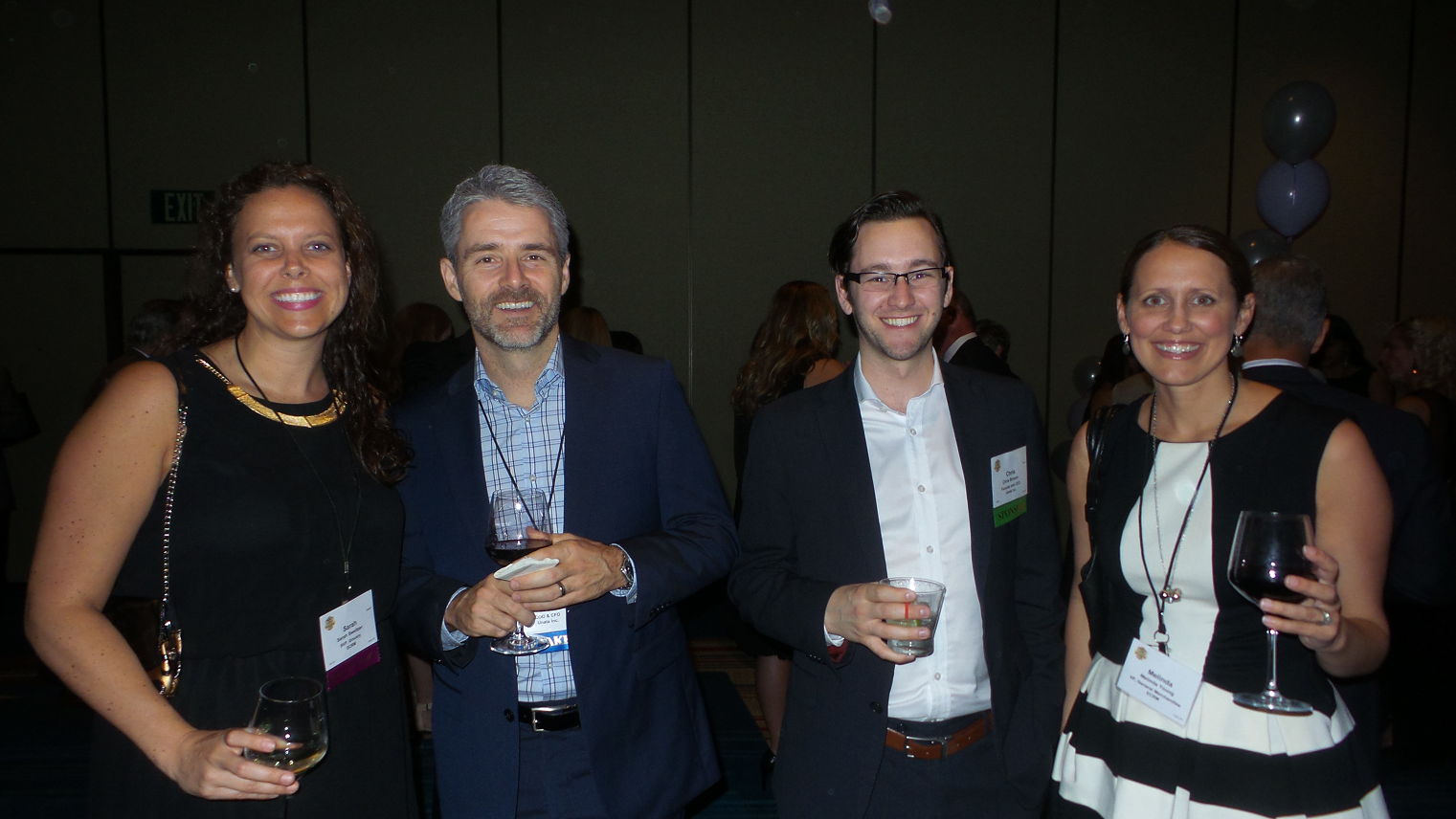From left: Sarah Sweitzer, Marc Faucher, CFO of event sponsor Unata, Chris Bryson, CEO of Unata, and Melinda Young