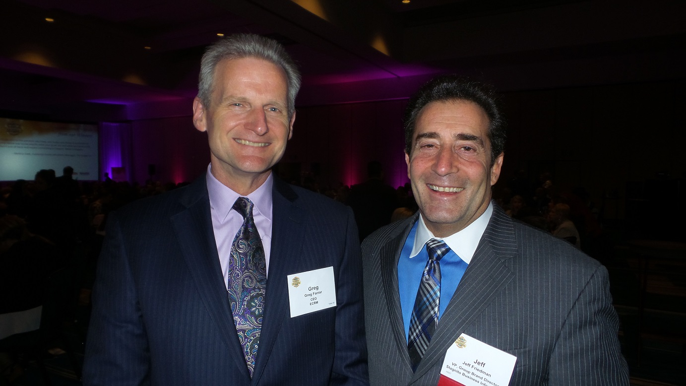 Greg Farrar, ECRM CEO (left), with Jeff Friedman, VP and Group Brand Director of Progressive Grocer