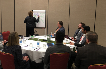 Amber Specialty Pharmacy's Julie Zatizabel guides her roundtable group in a discussion on health outcomes