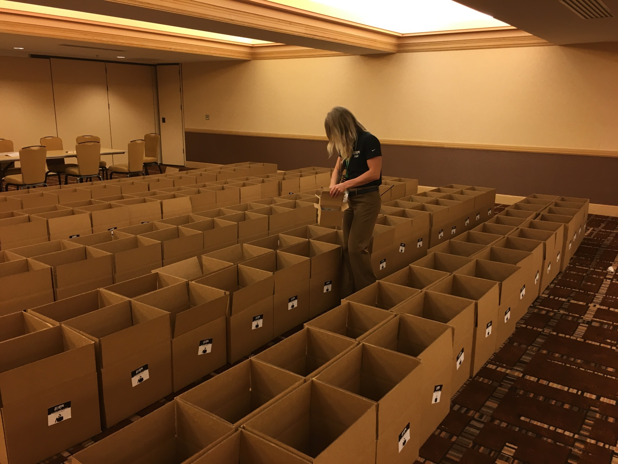 Retailer sample boxes being filled by an ECRM Account Manager