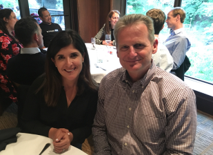 Nicky Jackson, CEO of RangeMe (left) and Greg Farrar, CEO of ECRM at a team dinner last week.