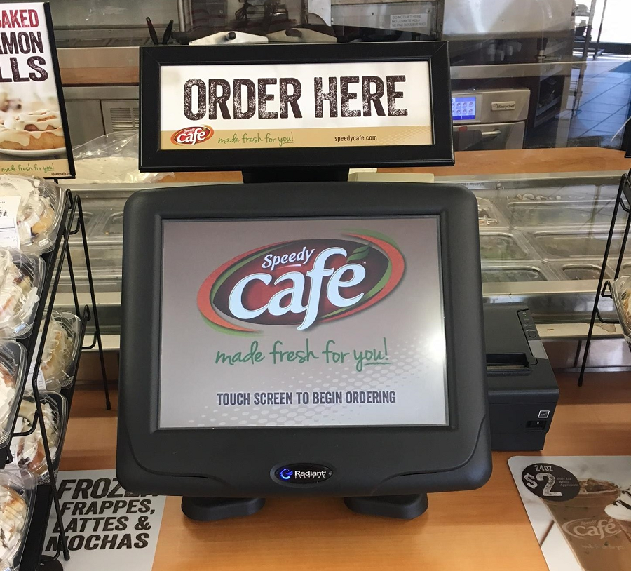 Consumers order meals from the touchscreen kiosks at the counter