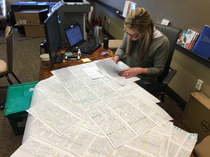 Scheduler Carson Smith works on a massive scheduling grid during an EPPS earlier this year